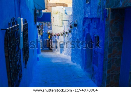 tourist in Morocco, chefchaouen blue city, streets and buildings painted in shades of blue, brightly colored