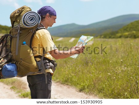 tourist is in the mountains and see the map