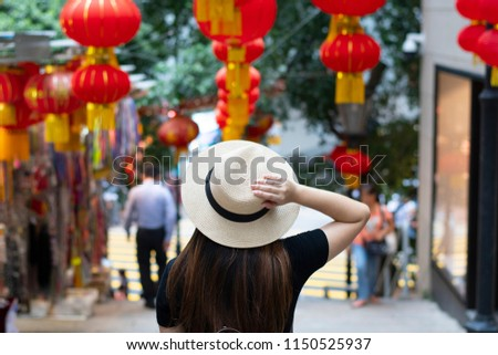 Tourist is walking and traveling on the street in Hong Kong travel district with decoration by Chinese lanterns beautiful sign.