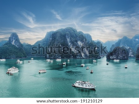 Tourist junks floating among limestone rocks at early morning in Ha Long Bay, South China Sea, Vietnam, Southeast Asia. Two images panorama