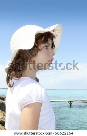 tourist little girl hat formentera turquoise sea Illetas Balearic Island