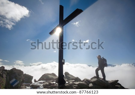 tourist looking at landscape from  top of Bettmerhorn mountain, Switzerland
