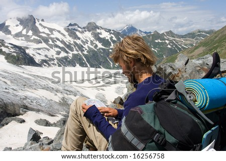 tourist looking to map in high mountains