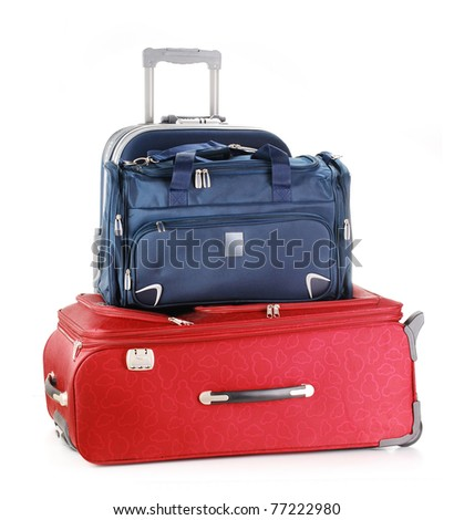 Tourist luggage consisting of large travel suitcases and a bag isolated on white.