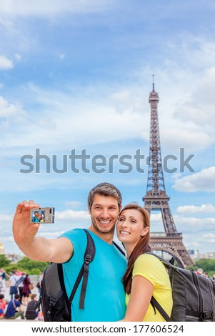 tourist making picture visiting city of love