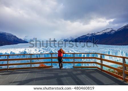 Shutterstock Tourist near the Perito Moreno Glacier, Argentina. Perito Moreno is a glacier located in the Los Glaciares National Park in the Argentinian Patagonia.