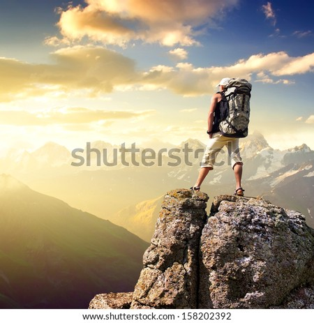 Tourist on the mountain top. Sport and active life concept