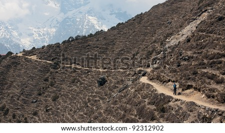 Tourist on the upper path from the Namche Bazar to Khumjung - Nepal, Himalayas