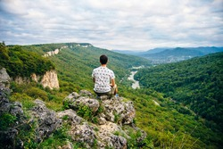 tourist on Valley of the mountain river Belaya. Republic of Adygea. Western Caucasus. Russia