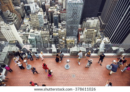 Tourist people taking pictures from rooftop on Manhattan skyscraper #378611026
