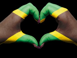 Tourist peru made by jamaica flag colored hands showing symbol of heart and love