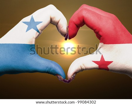 Tourist peru made by panama flag colored hands showing symbol of heart and love during sunrise