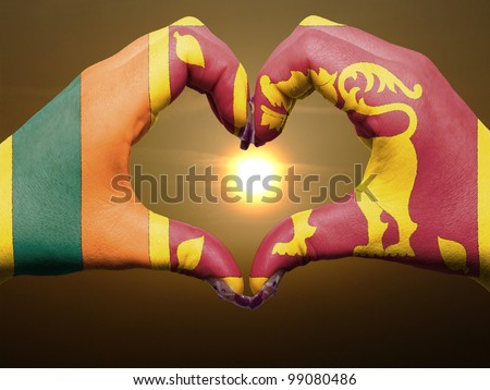 Tourist peru made by sri lanka flag colored hands showing symbol of heart and love during sunrise