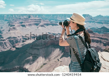 tourist photographer taking photo of sand mountain desert in the sunny day. young lens man hobby love travel wild. girl living healthy active lifestyle doing hike in beautiful nature landscape to US.