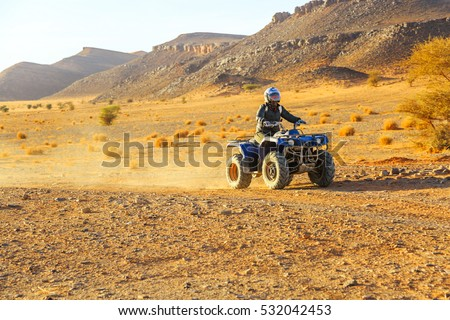 tourist piloting a quad in the Moroccan desert Stock photo ©