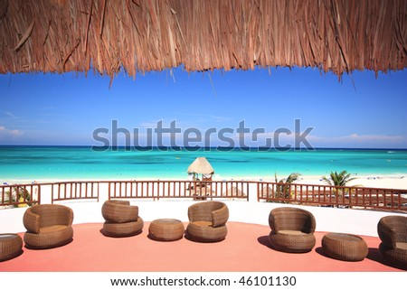 Tourist resort balcony overlooking a stunning tropical beach