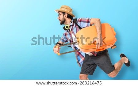 Tourist running fast over colorful background