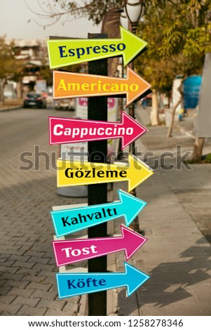 Tourist Sign With Pointers In Cafe With Coffee Option On Boards #1258278346