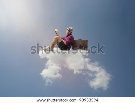 Tourist sitting on a cloud and reading a book