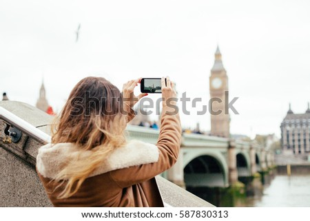 Tourist snapping taking a photo in London