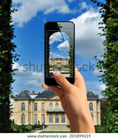 Tourist taking a picture with mobile phone of Rodin's Museum