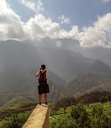Tourist taking picture landscape travel photography photocamera photographer concept. View point SaPa valley of mountains. Nature Landscape Sapa Lao Cai Province, Sa Pa countryside Vietnam.