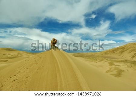Tourist  taking pictures to Dunes at gobi desert, Mongol Els.
