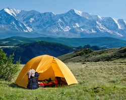 tourist tent camping in mountains