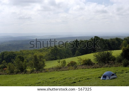 Tourist Tent in the Mountains - stock photo