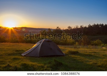 Tourist tent on the background of an old castle. #1086388076
