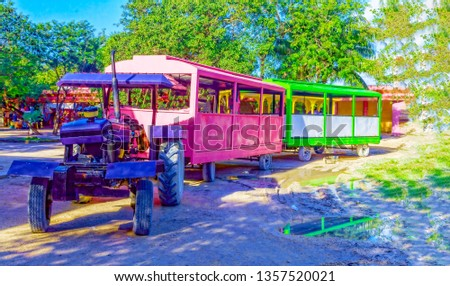 Tourist train, multi-colored cabins and a purple tractor. To the delight of tourists and their children. #1357520021