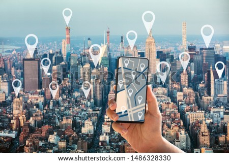 Tourist Using GPS Map Navigation Application On Mobilephone In New York City With Location Pointers #1486328330
