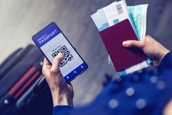 tourist using immunity passport app in mobile phone for travel