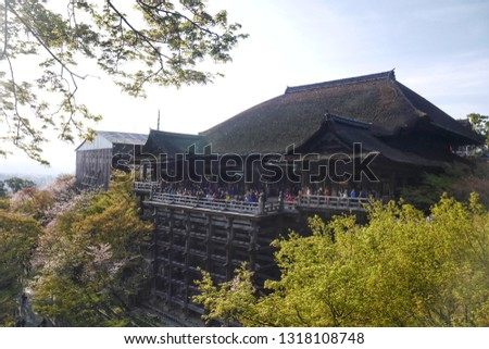 Tourist visits Kiyomizu-dera Temple in Kyoto, The old Buddhist temple is a UNESCO World Heritage site and one of the most famous temples in all of Japan. #1318108748