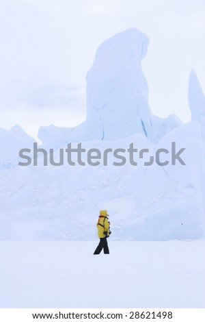 Tourist walking on the sea ice in the Weddell Sea, Antarctica