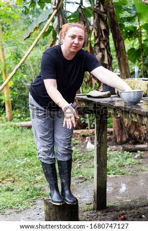 tourist washing her hands in typical indigenous environment toilet run commercial tourist water indigens flow rural female nails bathroom ecuador hand real indigenous travel woman index posing native