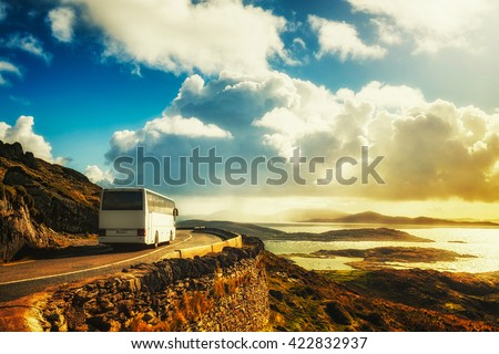 Tourist white bus on mountain road. Ring of Kerry, Ireland. Travel destination