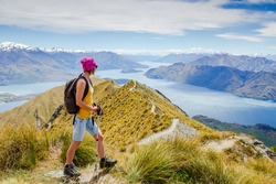 Tourist with a backpack and mountain panorama. New Zealand