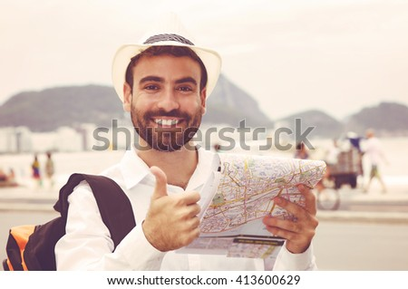 tourist with map at rio de...