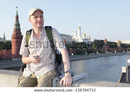 Tourist with mobile phone against Kremlin in Moscow, Russia