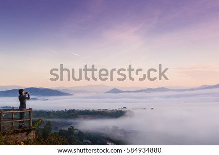 Shutterstock Tourist with Sunrise and sea of clouds over Pai District Mae Hong Son, THAILAND. View from Yun Lai Viewpoint is located about 5 km to the West of Pai town centre above the Chinese Village.