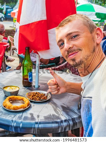 Tourist with thumbs up for nepalese food breakfast with Sel Roti and chickpea in Kathmandu Nepal. Stock fotó ©