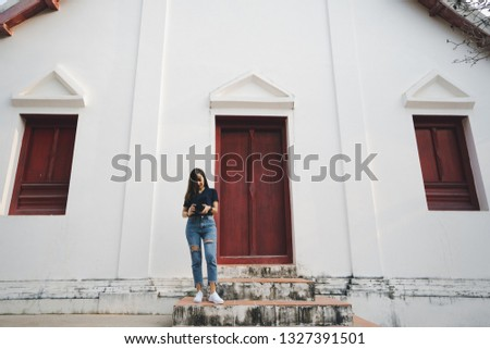 tourist woman a photographer stand in temple in traveler in vacation in Thailand nan province