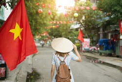 Tourist woman is traveling and sightseeing at Old Town Hoi An in Vietnam.
