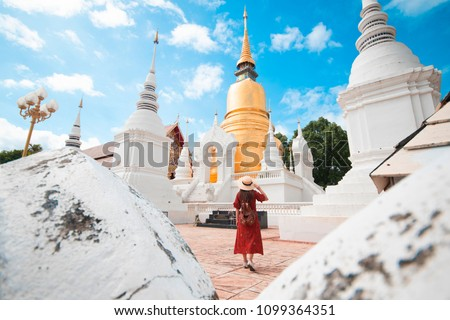 Tourist woman is traveling and sightseeing at Wat Suan Dok in Chiangmai, Thailand. Stock fotó ©