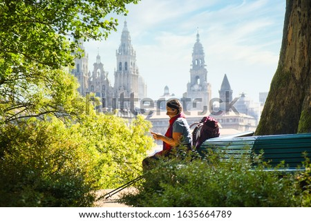 Tourist Woman On Pilgrimage At Santiago De Compostela With Phone Foto d'archivio ©
