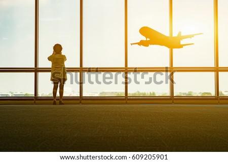 tourist women seeing plane at...