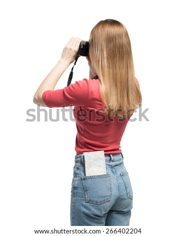 Tourist young woman is taking a picture. Isolated.