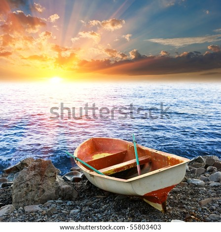 touristic  boat on a coast by a sunset