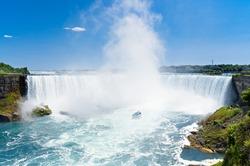 Touristic boat on Niagara falls. Horseshoe waterfall Canada side